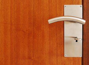 wooden door with metallic door handle with key